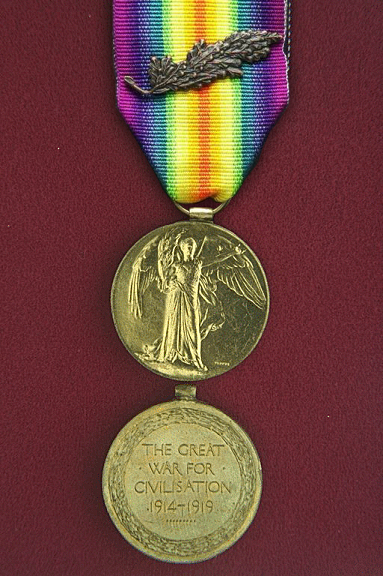 Victory Medal. A circular, copper medal, lacquered bronze, 1.42 inches in diameter.
